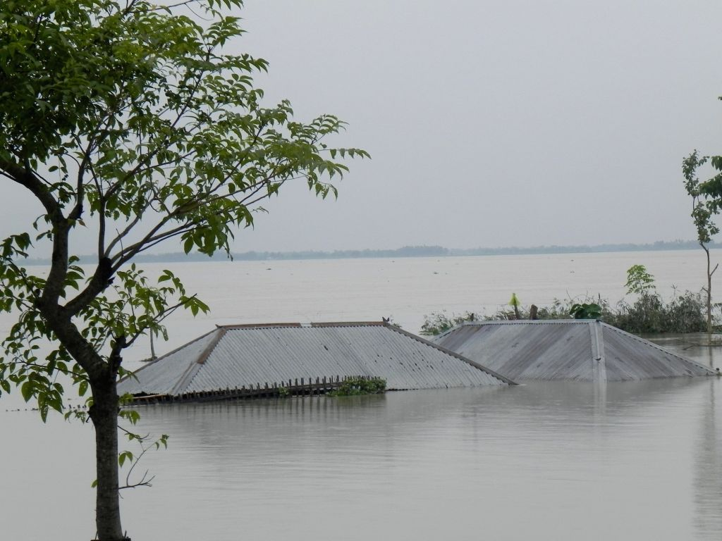 Cooch Behar: A submerged house in flood-hit Cooch Behar District of West Bengal on July 26, 2016.