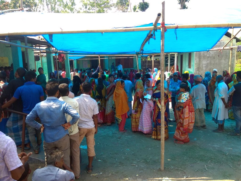 Cooch Behar: People wait in multiple queues to cast their votes for the first phase of 2019 Lok Sabha elections, in West Bengal's Cooch Behar, on April 11, 2019. (Photo: IANS)