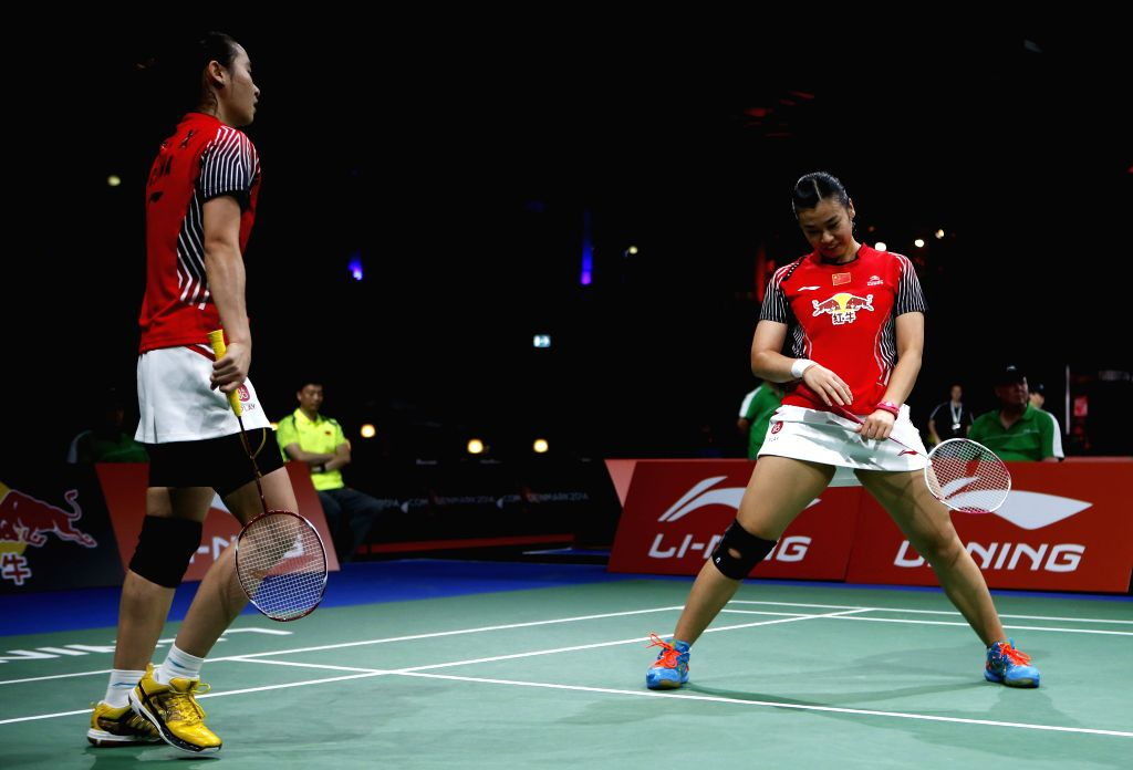Bao Yixin and Tang Jinhua(R) of China react after the Women's Doubles Round 1 match against Anggia Shitta Awanda and Della Destiara Harison of Indonesia on Day 3 .