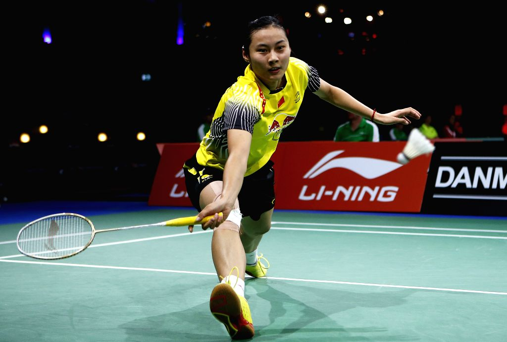 Wang Yihan of China returns the shuttle during the Women's Singles Round 1 match against Anna Thea Madsen of Denmark on Day 3 of Li Ning BWF World Championships ..