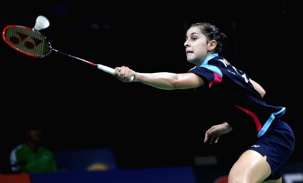 Carolina Marin of Spain returns the shuttle during the Women's Singles Round 3 match against Wang Yihan of China on Day 4 of Li Ning BWF World Championships 2014