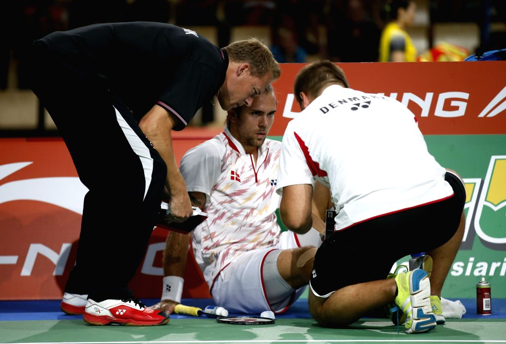 Jan O Jorgensen of Denmark receives medical treatment after the first set of the Men's Singles Round 3 match against Chou Tien Chen of Chinese Taipei on Day 4 of