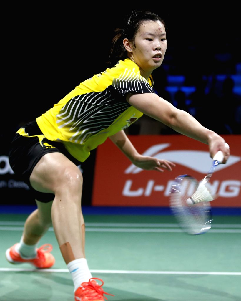 Li Xuerui returns the shuttle during the Women's Singles Quarter Finals match against Saina Nehwal of India on Day 5 of Li Ning BWF World Championships 2014 at ...