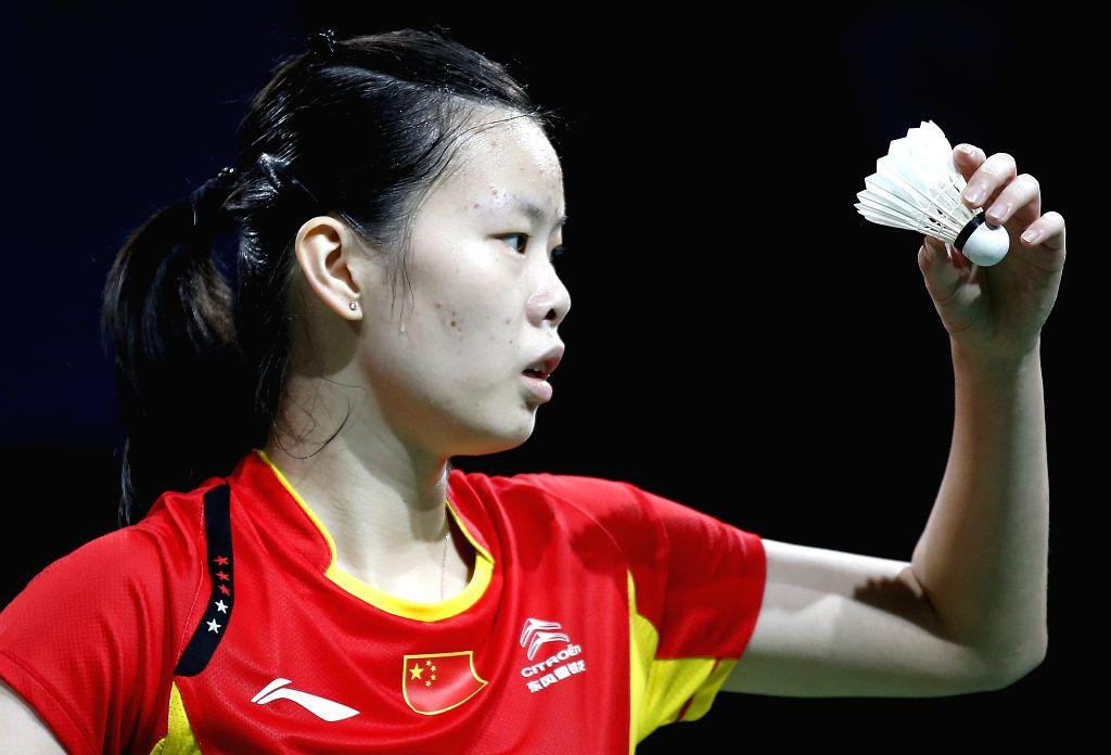 Li Xuerui of China serves during the Women's Singles Semifinal against Minatsu Mitani of Japan on Day 6 of Li Ning BWF World Championships 2014 at Ballerup Super .