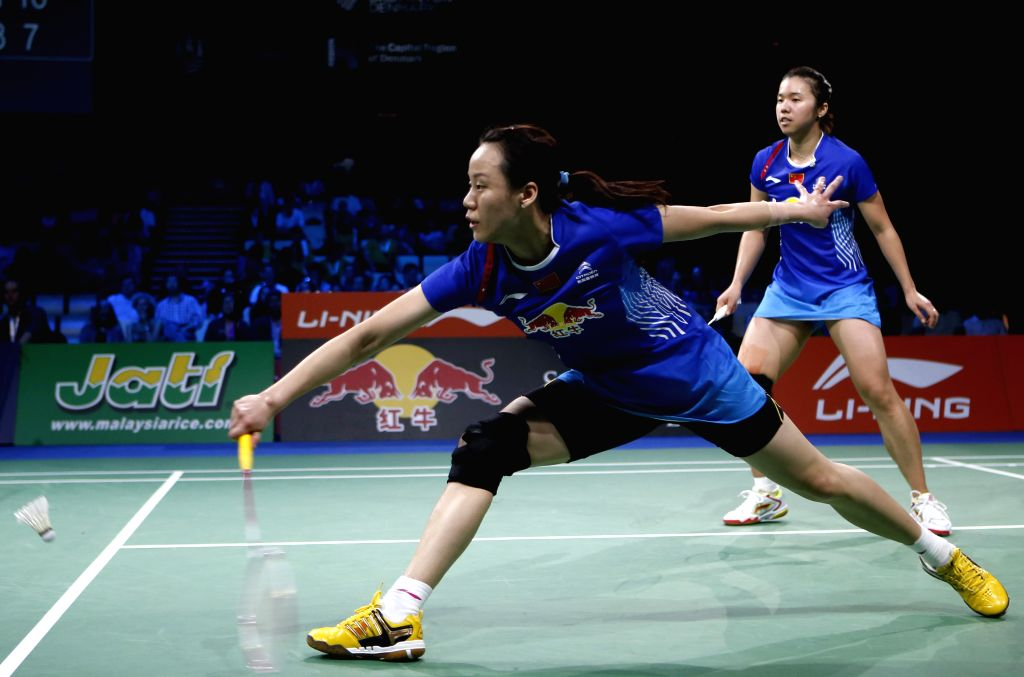 Tian Qing and Zhao Yunlei(R) of China return the shuttle during the Women's Doubles Semifinal match against Lee So Hee and Shin Seung Chan of South Korea on Day 6