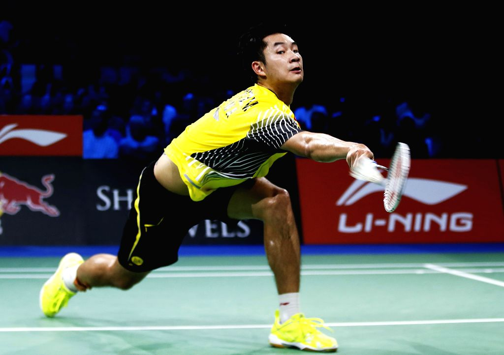Wang Zhengming of China competes during a men's singles quarterfinal match against Chong Wei Lee of Malaysia on Day 5 of Li Ning BWF World Championships 2014 at .