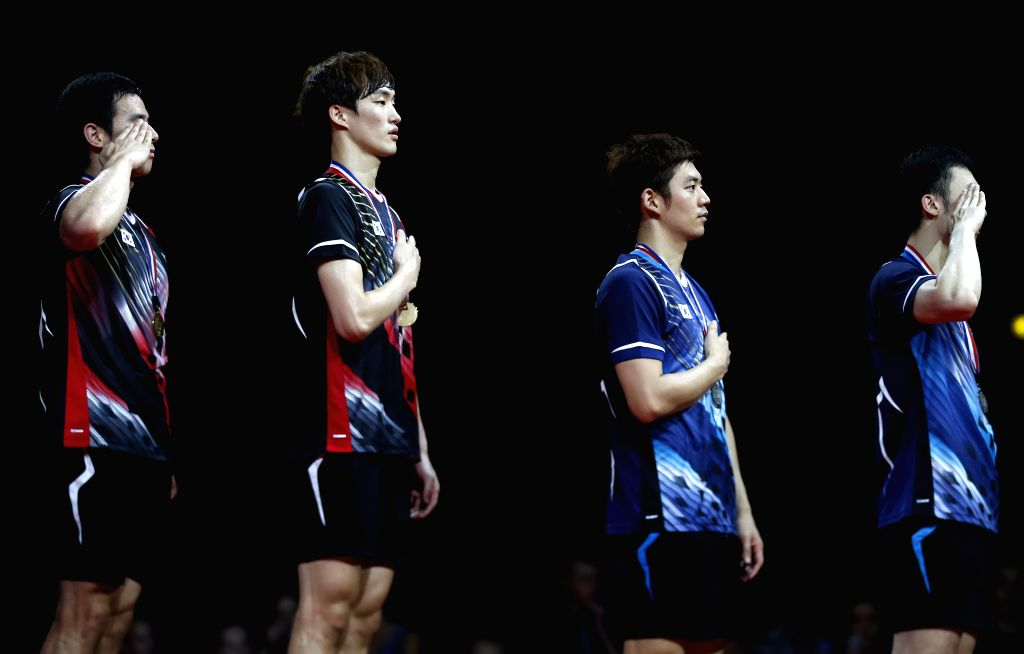 Ko Sung Hyun (1st, L) and Shin Baek Choel (2nd, L) of South Korea celebrate during the awarding ceremony for the Men's Doubles Finalon Day 7 of Li Ning BWF World .