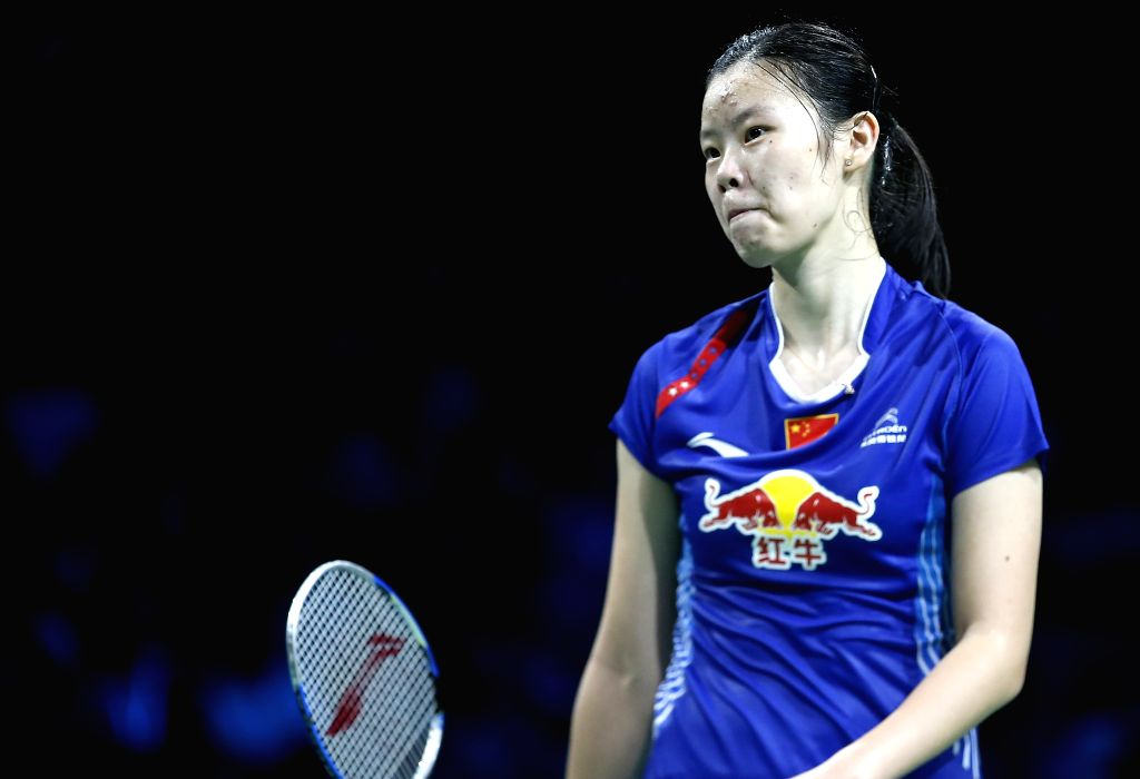 Li Xuerui of China reacts during the Women's Singles Final against  Carolina Marin of Spain on Day 7 of Li Ning BWF World Championships 2014 at Ballerup Super ...