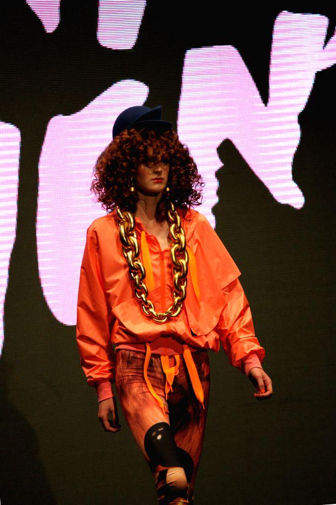 A model presents a creation by Danish Designer Nicholas Nybro during the ongoing Copenhagen Fashion Week in Copenhagen, Denmark, Aug.7, 2014.
