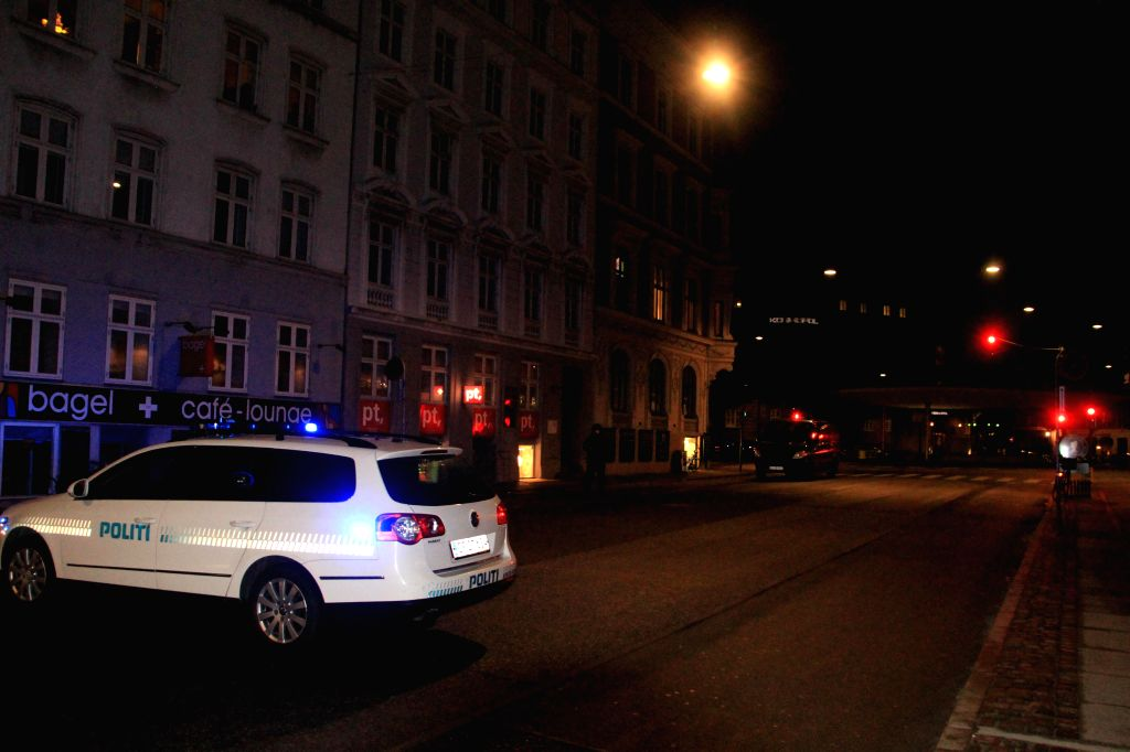 A police vehicle parks near the site of shooting in Copenhagen, Denmark, early Feb. 15, 2015. A shooting occurred near Norreport subway station early Sunday, ...