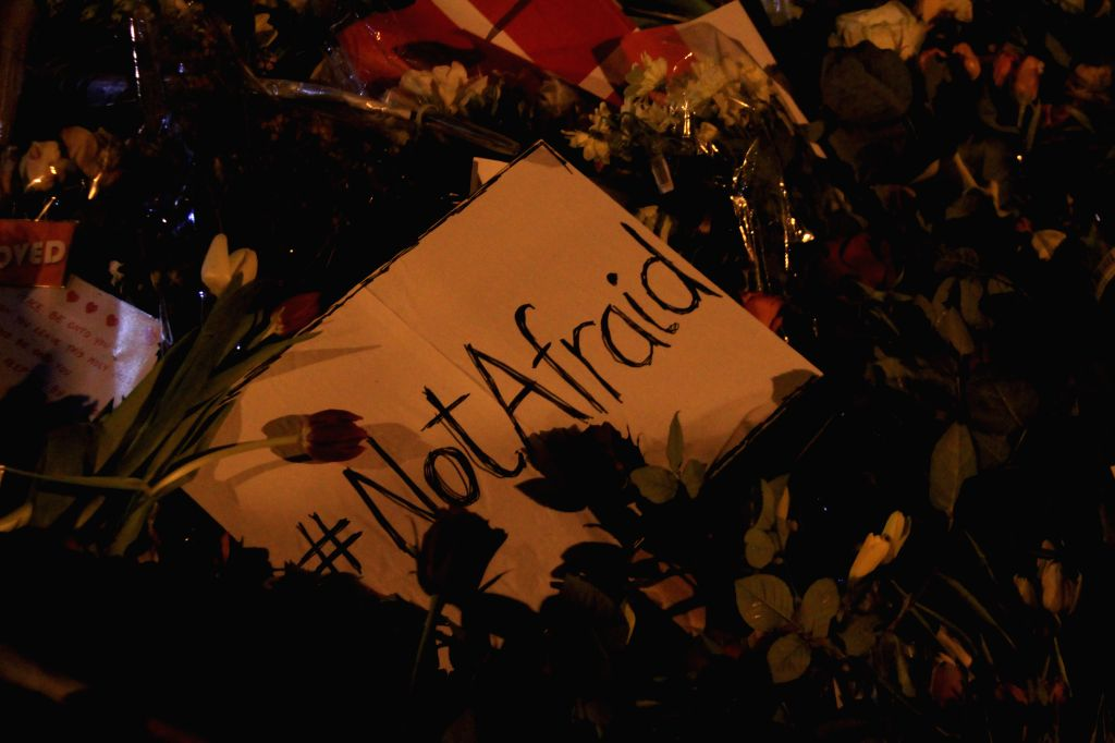 """A board with the words """"Not Afraid"""" is seen during a memorial vigil for those killed by a gunman at the weekend in Copenhagen, Denmark, on Feb. 16, ..."""
