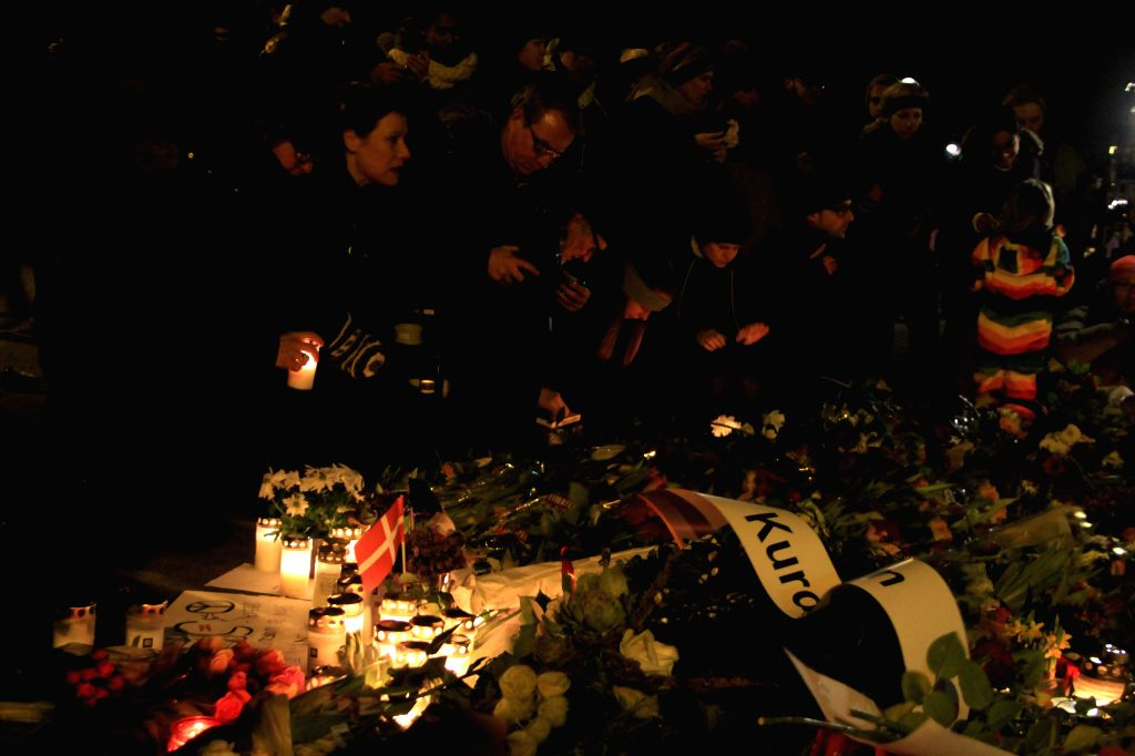 People attend a memorial vigil for those killed by a gunman at the weekend in Copenhagen, Denmark, on Feb. 16, 2015. Tens of thousands of citizens gathered in ...