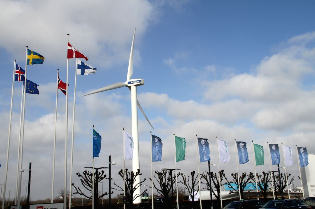 A wind turbine is seen outside the Bella Center conference and exhibition center in Copenhagen, Denmark, on March 10, 2015. EWEA Offshore 2015, organized by The ...