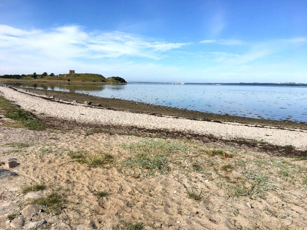 COPENHAGEN, Sept. 3, 2019 - File photo taken on July 17, 2019 shows the remote beach of Kaloe Slotsruin, with the background of Kaloe Castle Ruins in Jutland, Denmark. Volunteers who help keep Danish ...