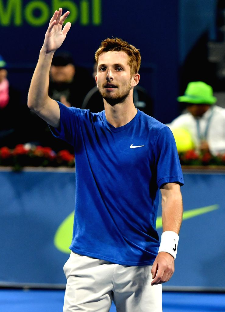 Corentin Moutet of France celebrates after winning the singles semifinal match against Stan Wawrinka of Switzerland at ATP Qatar Open tennis tournament in Doha, Qatar, ...