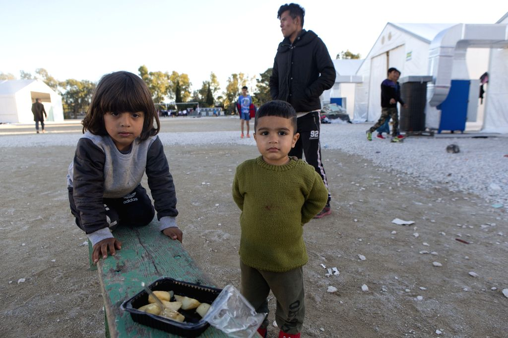 CORINTH (GREECE), Dec. 8, 2019 Children are seen at the Corinth refugee transit camp in Corinth, Greece, on Dec. 8, 2019. Some 90,000 refugees and migrants currently stranded in Greece, ...