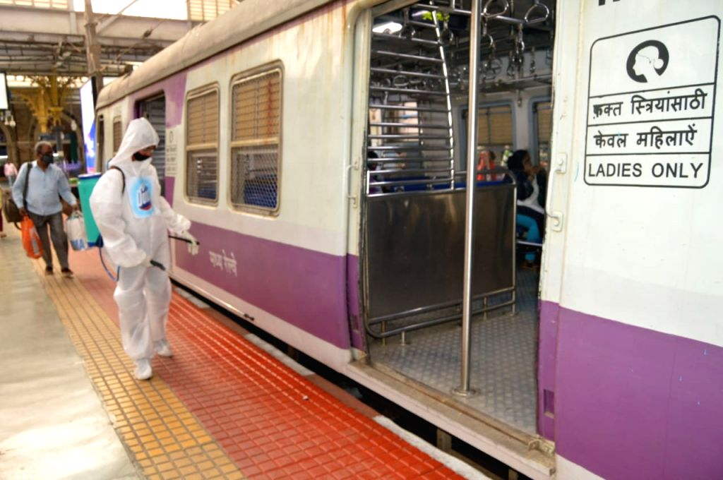 Corona virus one's against spread on reason Central Railway local train in ppe kit in employees sanitized  fogging at CSTM in Mumbai on Tuesday February 23, 2021.