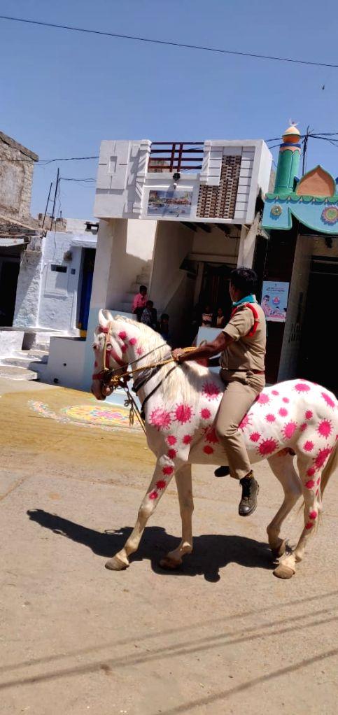 Coronavirus awareness campaign on horseback by Maruti Shankar, police sub-inspector of Papili town, Kurnool district, Andhra Pradesh.