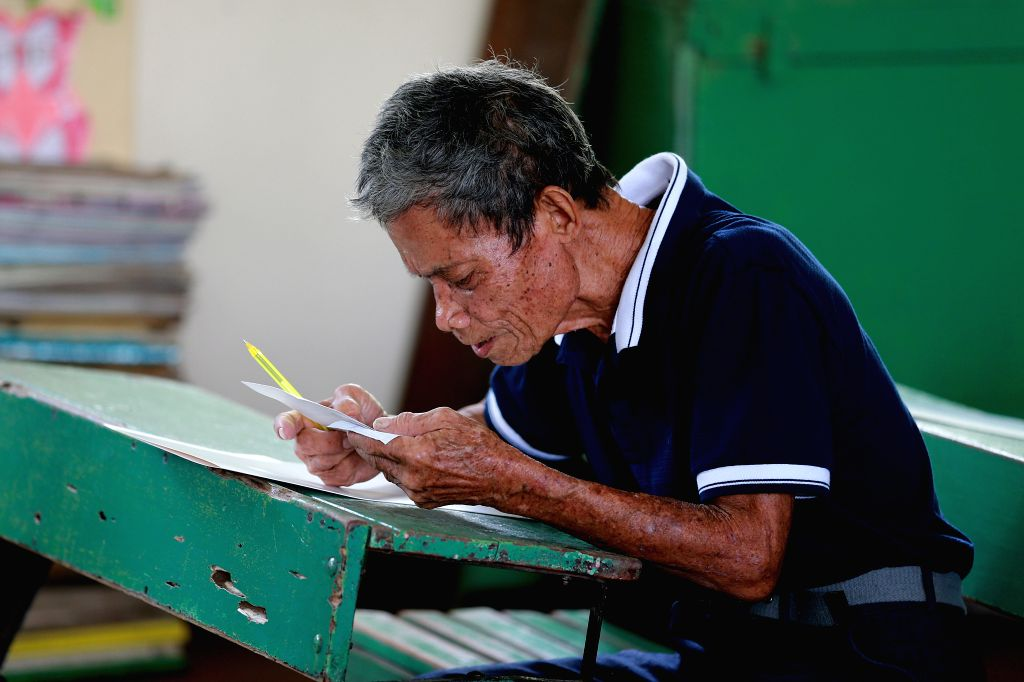 COTABATO CITY, Jan. 21, 2019 - An elderly man casts his vote at a polling center in Cotabato City, the Philippines, January 21, 2019. Muslim Filipinos cast their vote on Monday to ratify the landmark ...