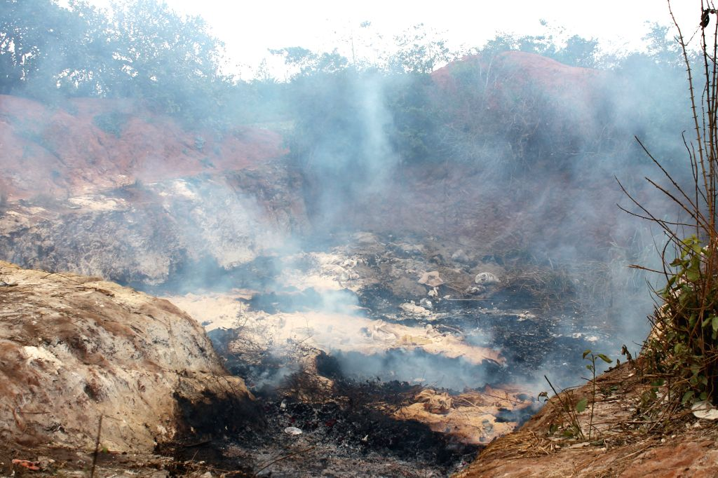 COTONOU, Sept. 10, 2016 (Xinhua) -- Photo taken on Sept. 10, 2016 shows incineration site of spoiled wheat flour at the Tori-Avame landfill site, 30 kilometers north of Cotonou, Benin. Three people were killed and some 60 others injured in an explosi - Seydou Alassane