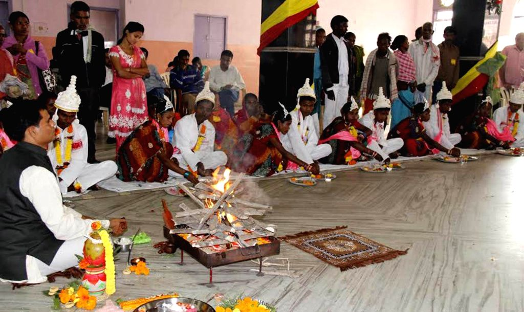 Couples perform rituals as they get married during a community marriage ceremony at Sanganeria Dharamsala in Guwahati on Dec.15, 2013.