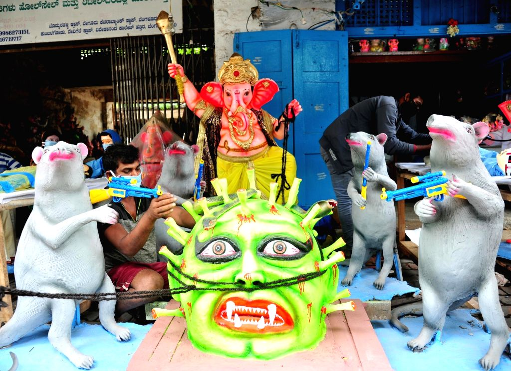 COVID-19 pandemic themed Ganesha idols on RV road attract people's attention, ahead of Ganesh Chaturthi celebrations in Bengaluru on Aug 1, 2020.
