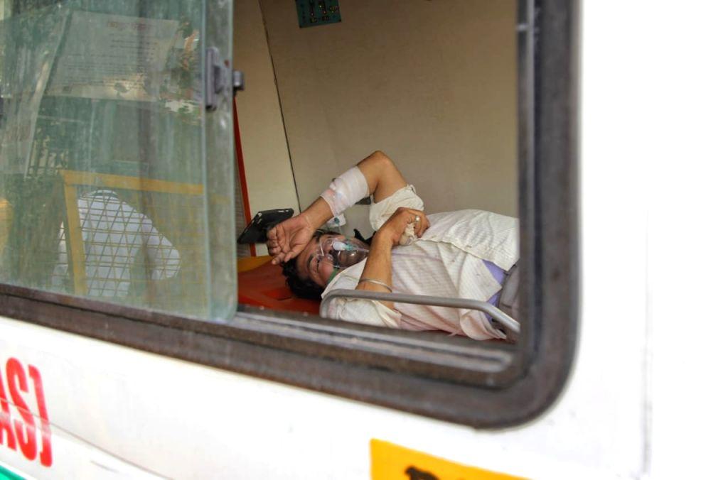 Covid-19 Patient waiting for bed outside Lok nayak jai parkash hospital (LNJP) in new Delhi on Friday April 23, 2021.