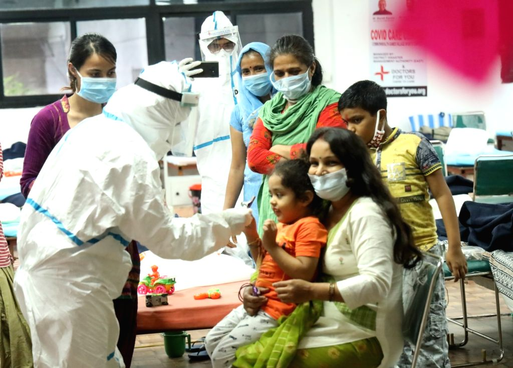 COVID-19 patients celebrate Raksha Bandhan with health workers an their family members at the CWG Village Covid Care Center, in New Delhi on Aug 3, 2020.