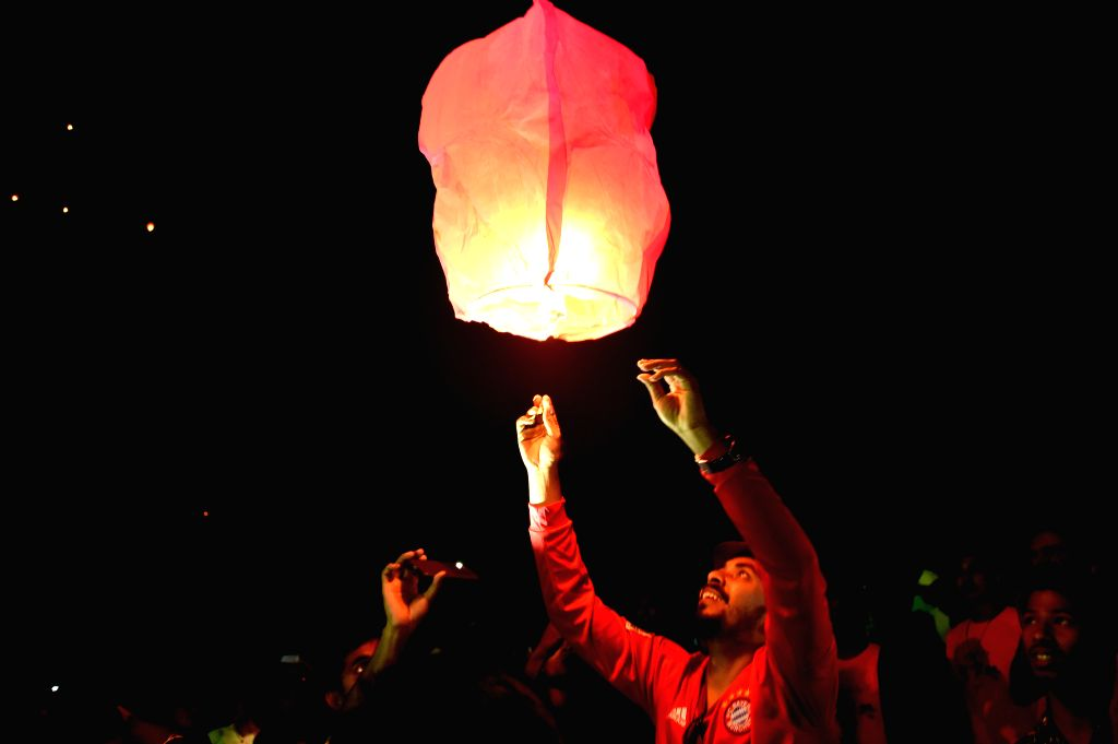 COX'A man releases a sky lantern during a two-day kite festival kicked off in Cox's Bazar in southeastern Bangladesh on Feb. 1, 2019.