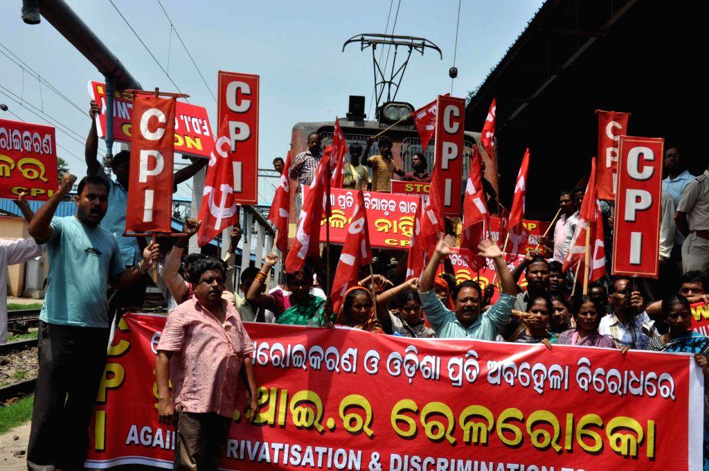 CPI activists stop Bhubaneswar-New Delhi Rajdhani Express to protest against Rail Budget 2014-15 at Bhubaneswar railway station on July 9, 2014. (Photo : Arabinda Mahapatra/IANS)