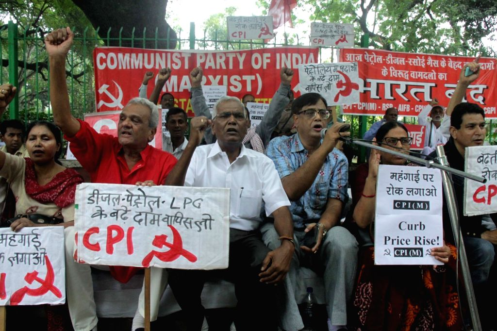 CPI General Secretary D Raja and others stage a demonstration during a day-long Bharat Bandh or nationwide shutdown called by the Congress and Left parties to protest against rising fuel ...