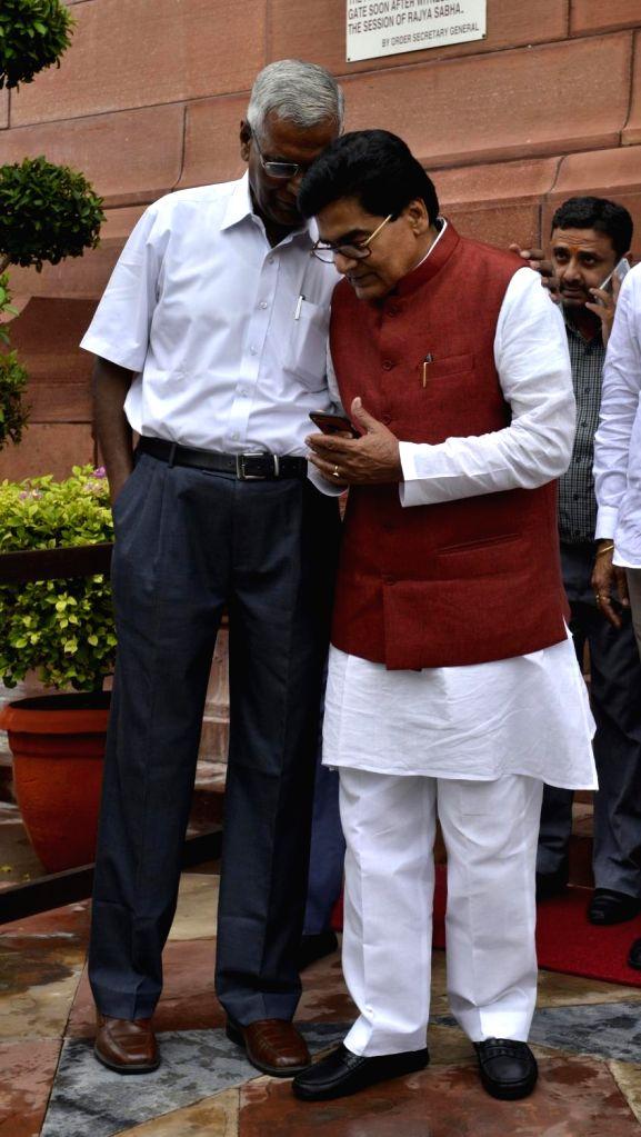CPI general secretary D Raja and Samamwadi Party leader Ram Gopal Yadav at Parliament in New Delhi on Aug 9, 2017. - Gopal Yadav