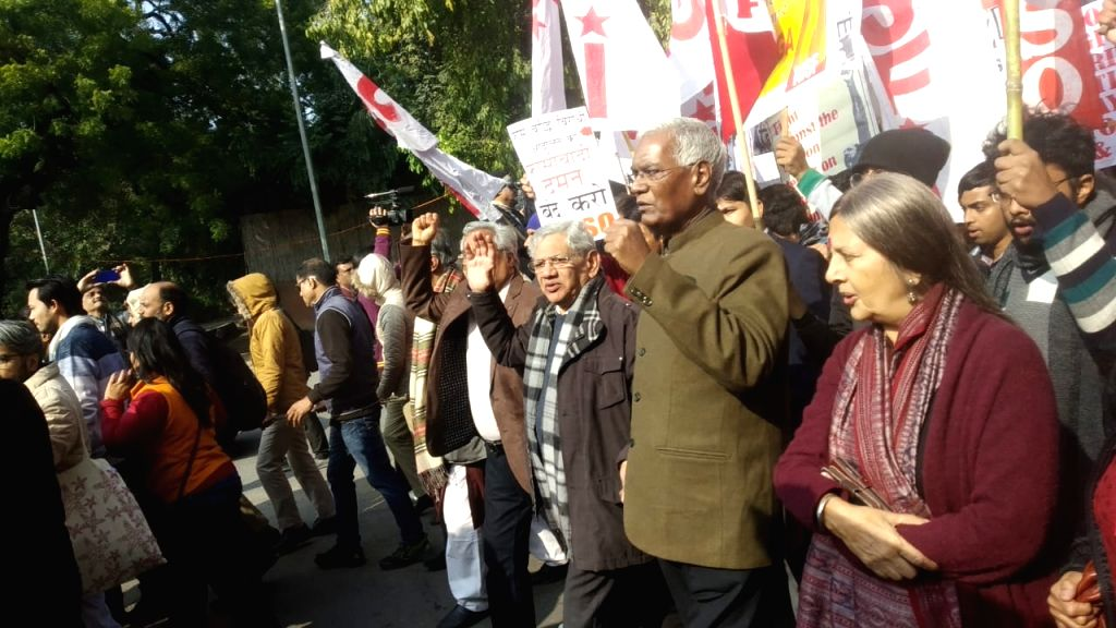 CPI leaders D. Raja and Brinda Karat and CPI-M leader Sitaram Yechury participate in a protest rally taken out by students from Mandi House towards the HRD Ministry, against recent ... - Sitaram Yechury