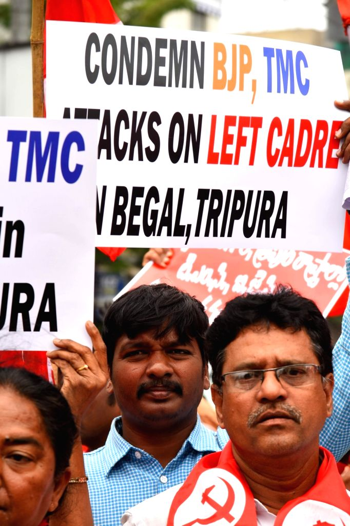 CPI-M activists stage a demonstration against attack on leftist party leaders and offices in West Bengal and Tripura; in Hyderabad on July 26, 2018.