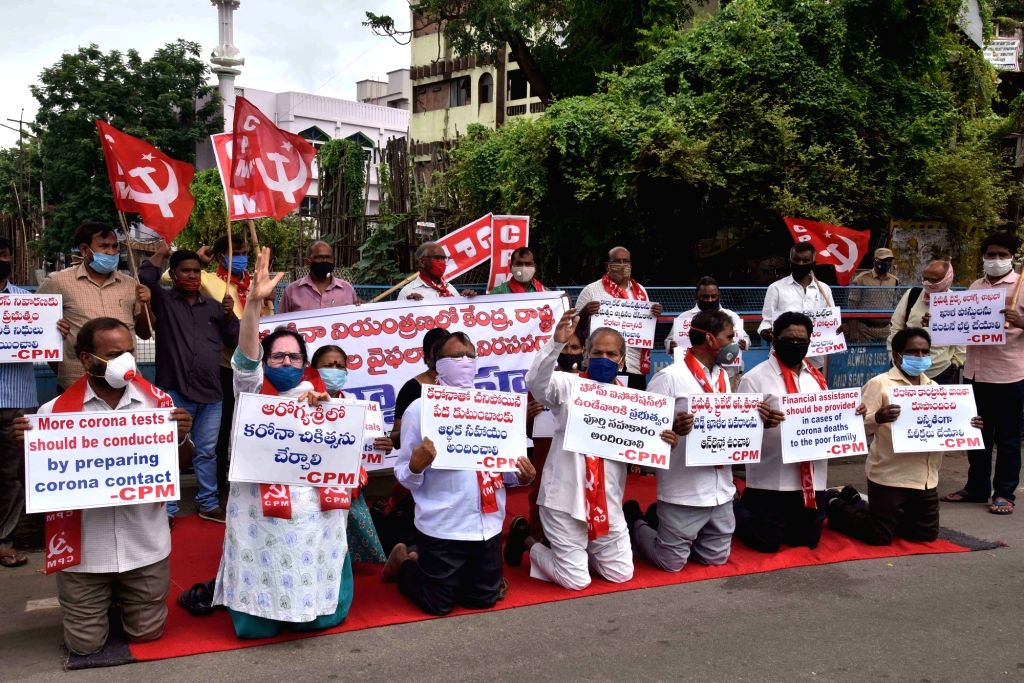 CPI-M activists stage a demonstration demanding more COVID-19 tests be conducted and financial assistance be given to poor families in case of corona deaths, in Hyderabad on July 16, 2020.