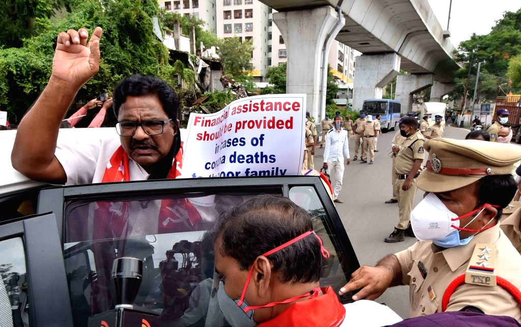 CPI-M activists staging a demonstration demanding more COVID-19 tests be conducted and financial assistance be given to poor families in case of corona deaths, being detained by the police ...