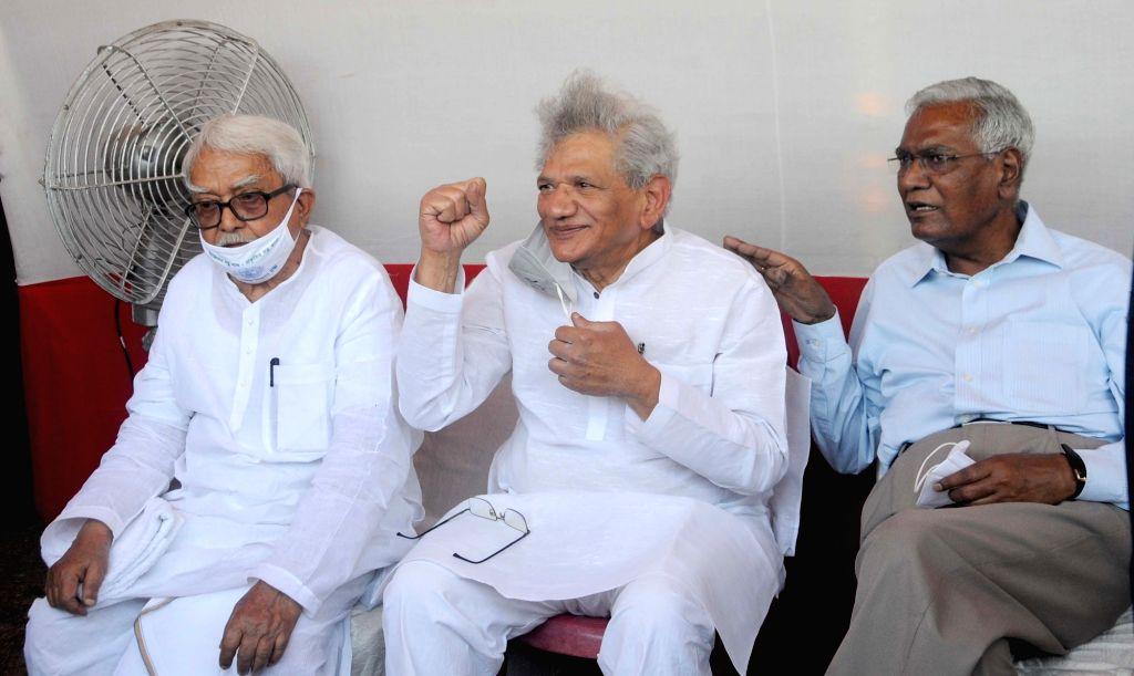 CPI(M) All India General Secretary Sitaram Yechury, CPI All India General Secretary D Raja, Left Front Chairman Biman Bose during Left, Congress, ISF joint rally at Brigade Parade Ground ... - Sitaram Yechury and Biman Bose
