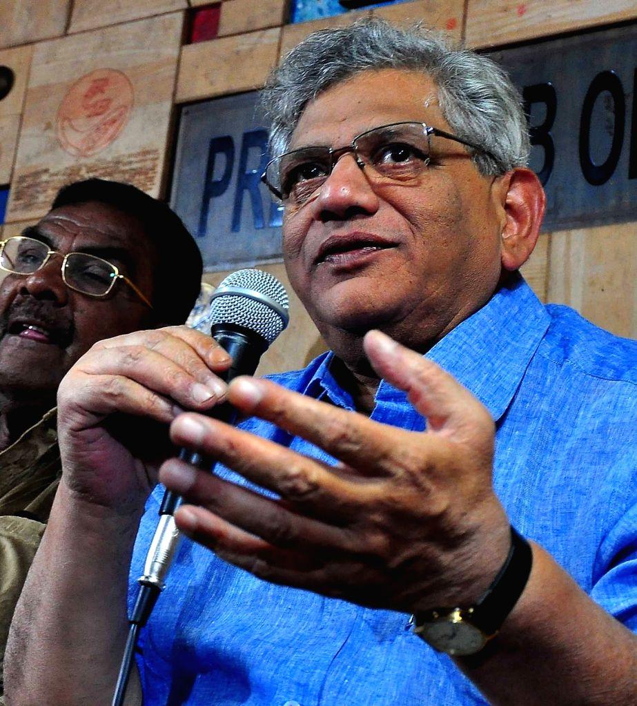 CPI(M) General Secretary Sitaram Yechury addresses a press conference at Press Club in Bengaluru on Nov 26, 2015. - Sitaram Yechury