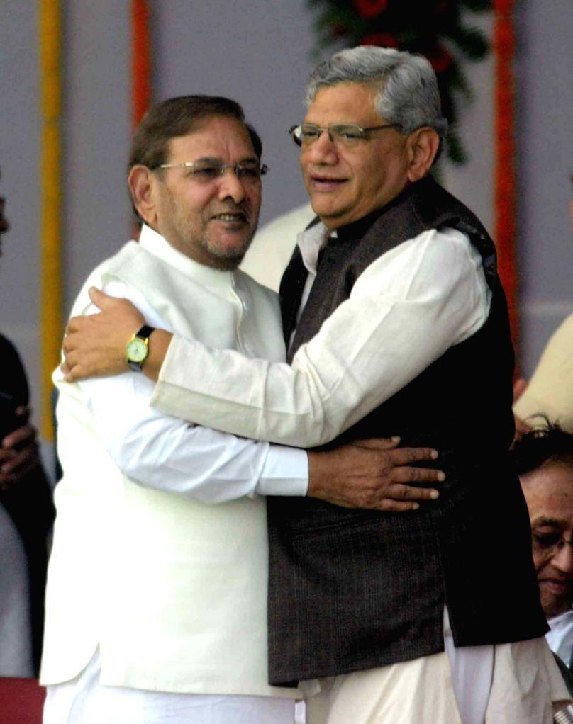 CPI-M general secretary Sitaram Yechury  and JD(U) chief Sharad Yadav during the swearing-in ceremony of the new JD-U-RJD-Congress coalition government in Patna, on Nov 20, 2015. - Sitaram Yechury and Sharad Yadav