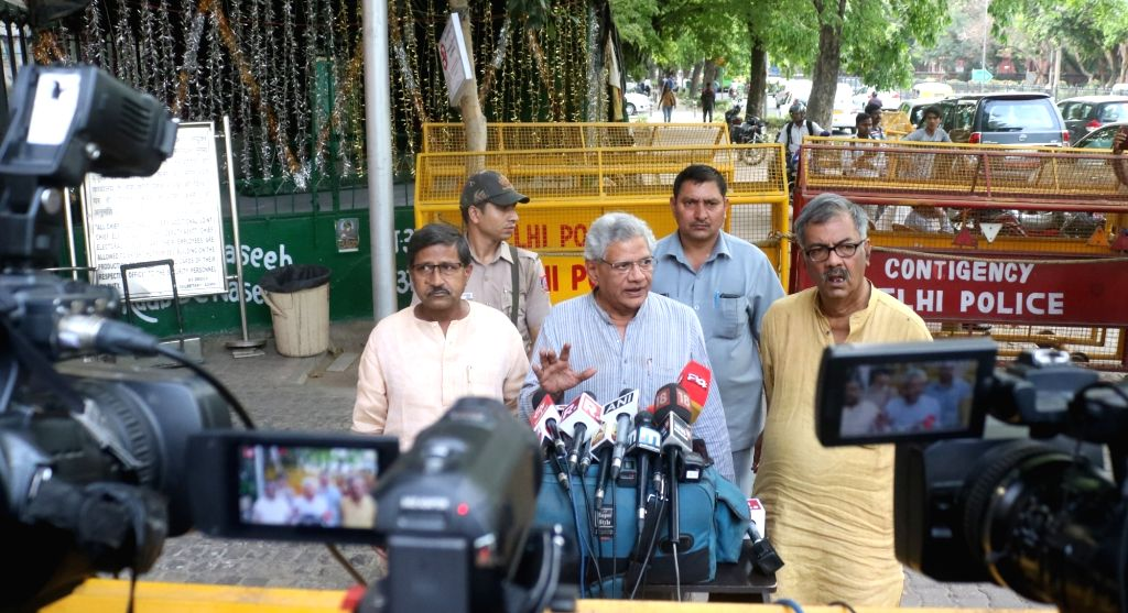 CPI-M General Secretary Sitaram Yechury talks to media persons after meeting the Chief Election Commissioner (CEC), in New Delhi on April 15, 2019. - Sitaram Yechury