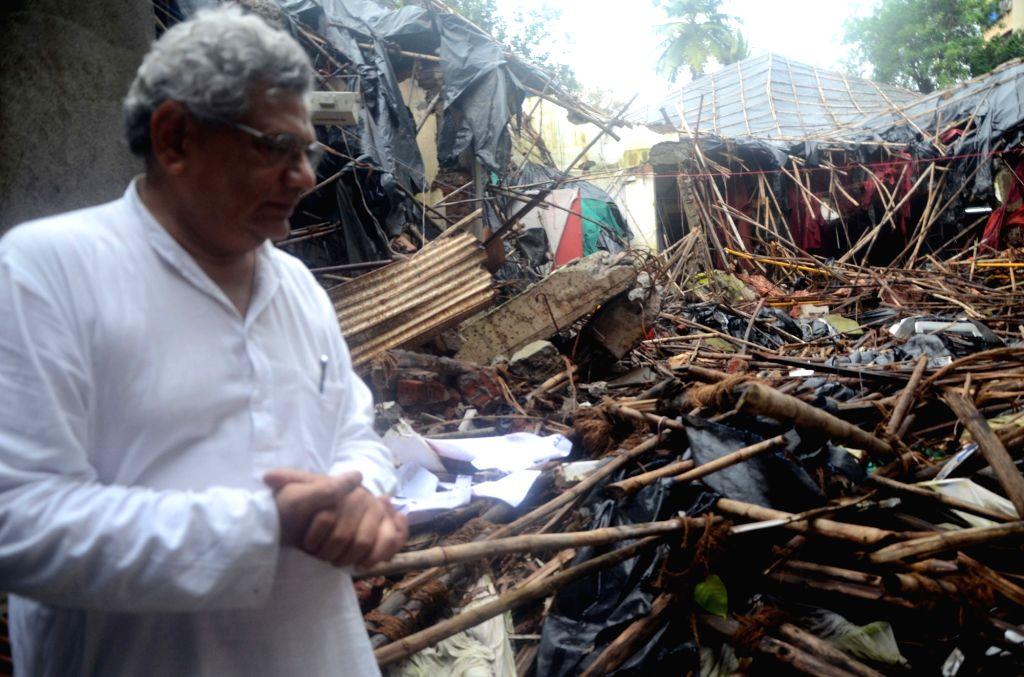CPI-M General Secretary Sitaram Yechury visits the demolished Ambedkar Bhavan, Dadar, in Mumbi; on July 16, 2016. - Sitaram Yechury