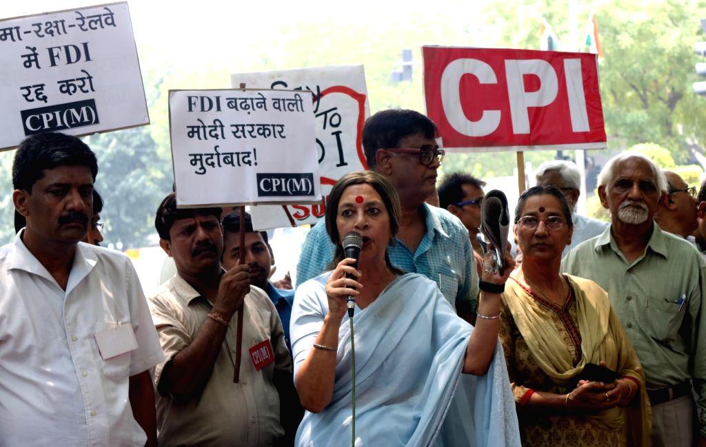 CPI (M) leader Brinda Karat addresses during a demonstration against FDI at Jantar Mantar in New Delhi on June 26, 2016. Seven left parties including CPI, CPI-M , Forward BlocK, RSP, ...
