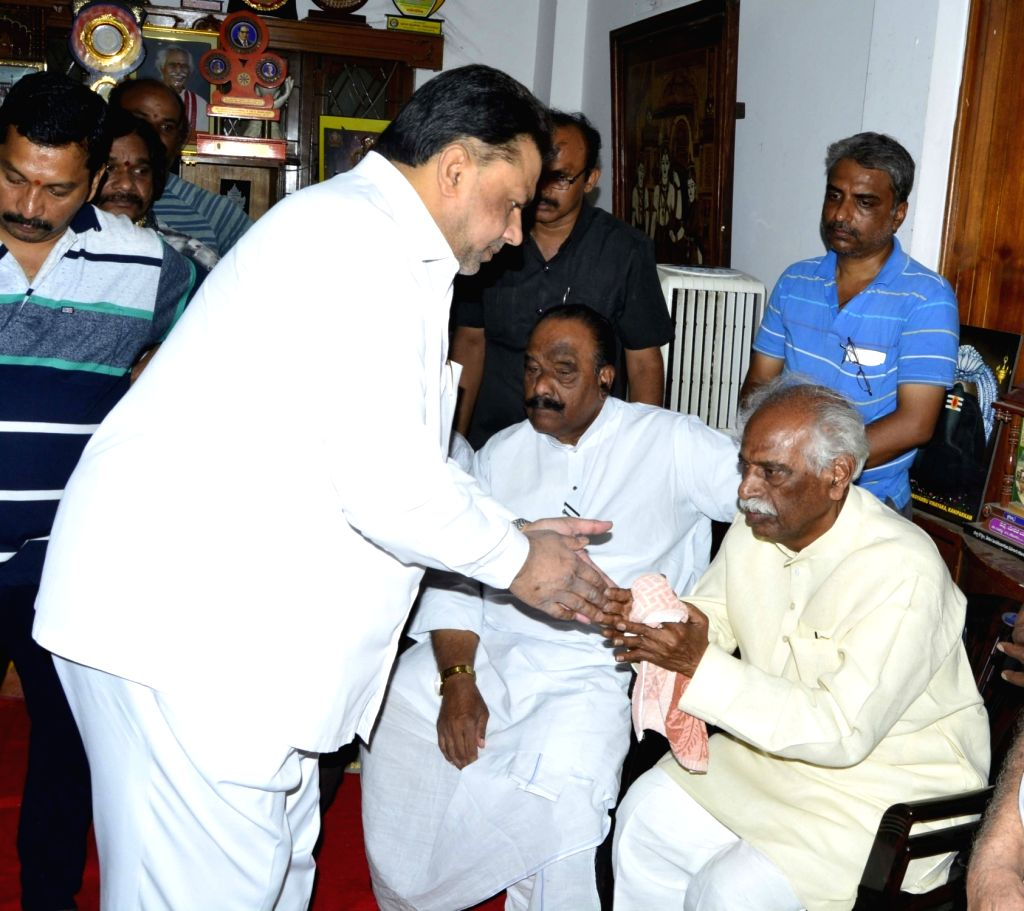 CPI-M leader Mohammed Salim consoles Union Minister and BJP leader Bandaru Dattatreya after his son Bandaru Vaishnav, 21, died of a massive heart attack in Hyderabad on May 23, 2018.