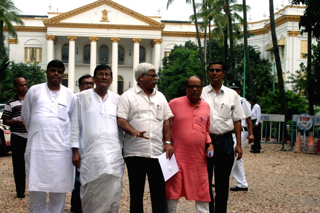 CPI(M) leader Sujan Chakrabarty, CPM leader and Siliguri mayor Ashok Bhattacharya with other leaders come out after meeting with West Bengal Governor Keshari Nath Tripathi in Kolkata on July ... - Keshari Nath Tripathi