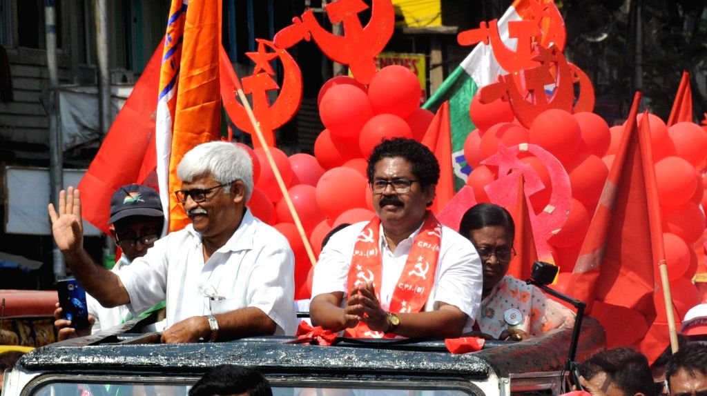 CPI(M) leader Sujan Chakraborty along with Sanjukta Morcha candidate of Dumdum constituency Palash Das at a road during the State Assembly election in Kolkata on Sunday, April 11th, ... - Sujan Chakraborty