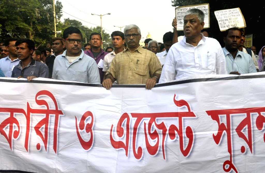 CPI-M leader Sujan Chakraborty, Congress leader Abdul Mannan and others party leaders participate during a rally taken out by Chit Fund Sufferers Forum in Kolkata on Nov 21, 2016. - Sujan Chakraborty