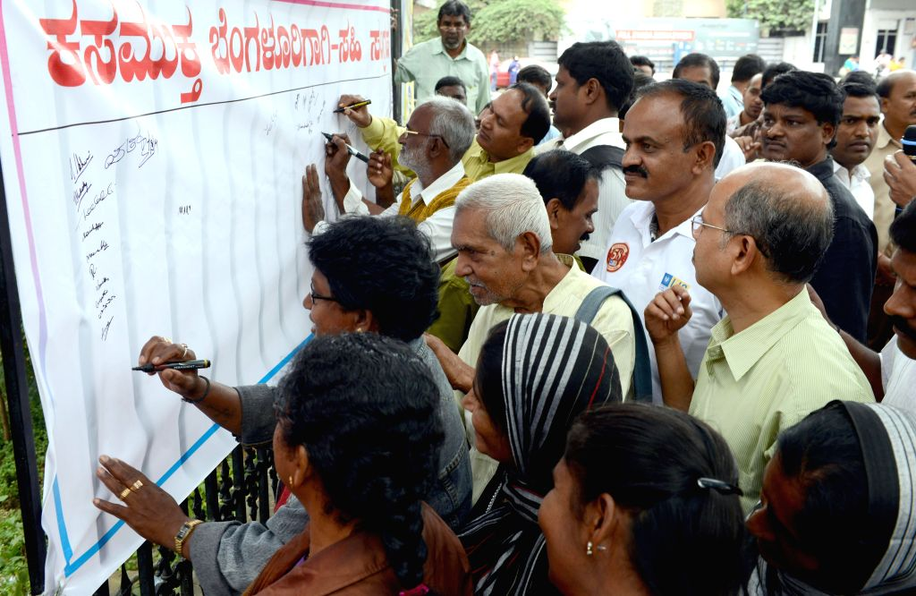 CPI (M) leaders participate in a signature campaign for garbage free Bangalore at BBMP office in Bangalore on Sept 7, 2014.