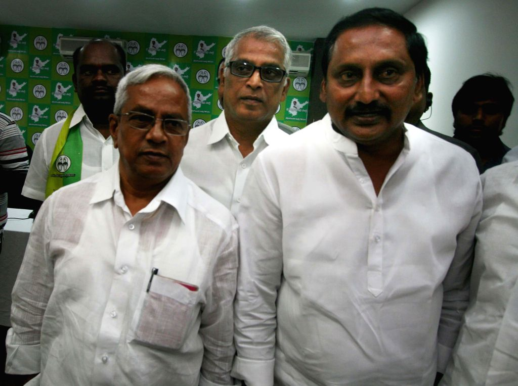 CPI (M) State secretary for Andhra Pradesh P. Madhu with Jai Samaikyandhra Party leader N Kiran Kumar Reddy during a meeting in Hyderabad on April 16, 2014.