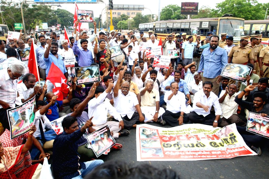 CPI-M workers block road as they stage a demonstration against the death of civilians in police firing during anti-Sterlite protests in Tamil Nadu's Toothukudi; in Chennai on May 23, 2018.