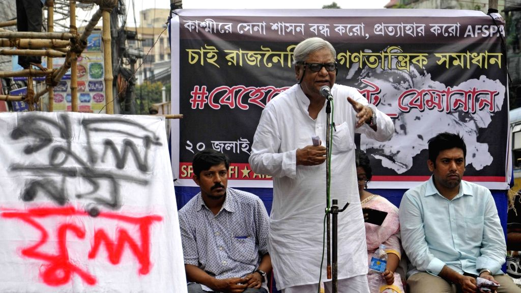 CPI-M workers participate in a protest rally demanding withdrawal of military force from Kashmir valley in Kolkata on July 20, 2016.